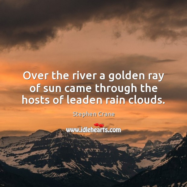 Over the river a golden ray of sun came through the hosts of leaden rain clouds. Image