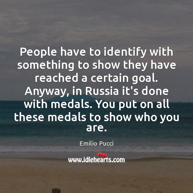 People have to identify with something to show they have reached a Goal Quotes Image
