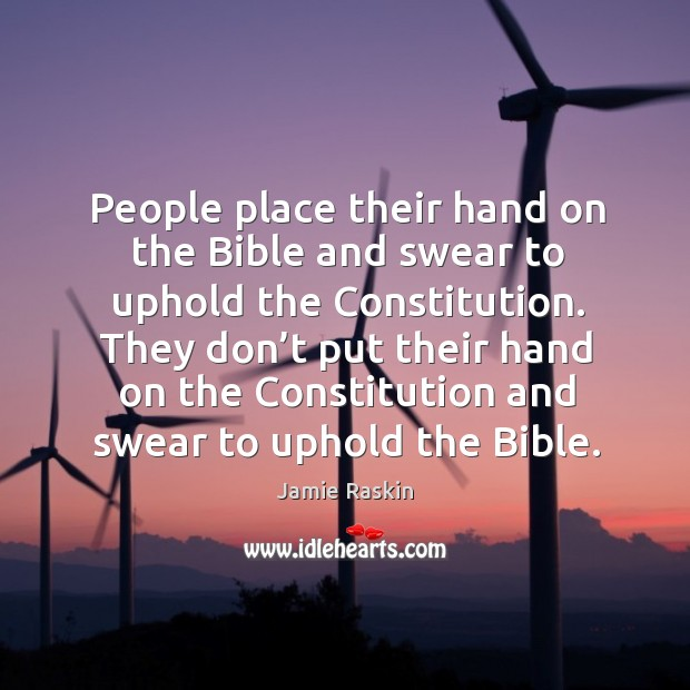People place their hand on the bible and swear to uphold the constitution. Image