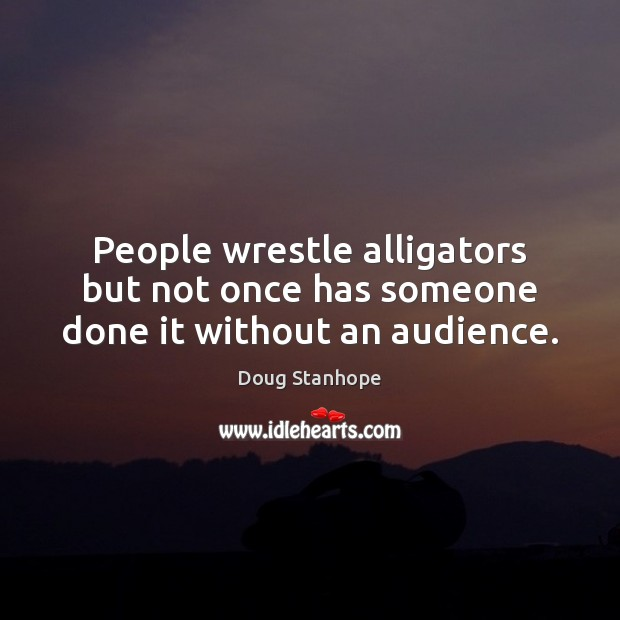 Image, People wrestle alligators but not once has someone done it without an audience.
