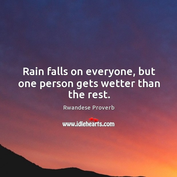 Rain falls on everyone, but one person gets wetter than the rest. Rwandese Proverbs Image