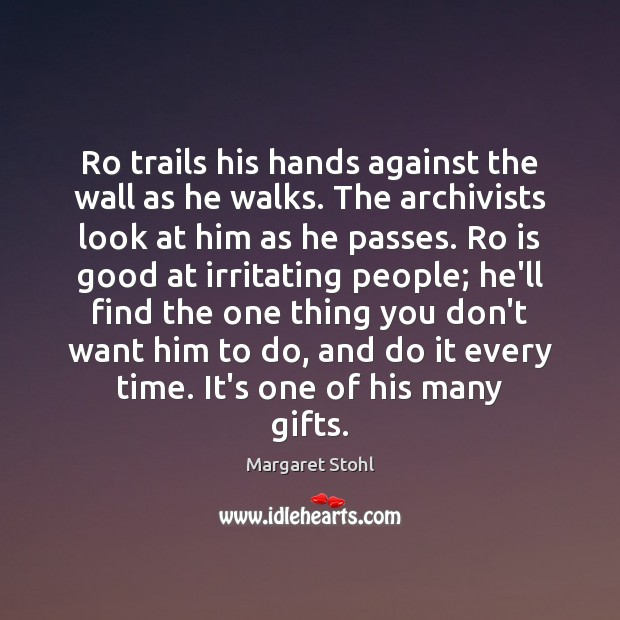 Image, Ro trails his hands against the wall as he walks. The archivists