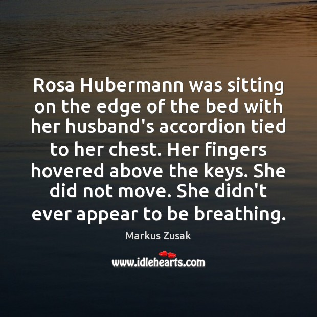 Rosa Hubermann was sitting on the edge of the bed with her Image