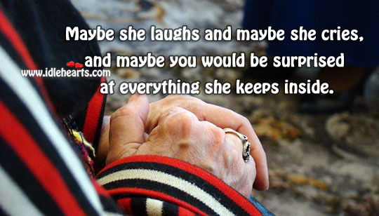 Maybe she laughs and maybe she cries Image