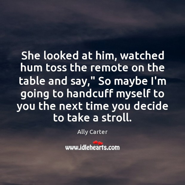 She looked at him, watched hum toss the remote on the table Image