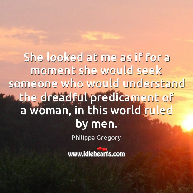 She looked at me as if for a moment she would seek Image