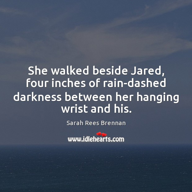 She walked beside Jared, four inches of rain-dashed darkness between her hanging Image