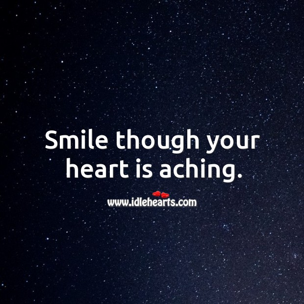 Smile though your heart is aching. Image