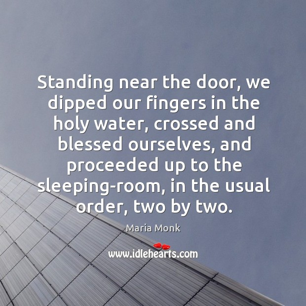 Standing near the door, we dipped our fingers in the holy water, crossed and blessed ourselves Image