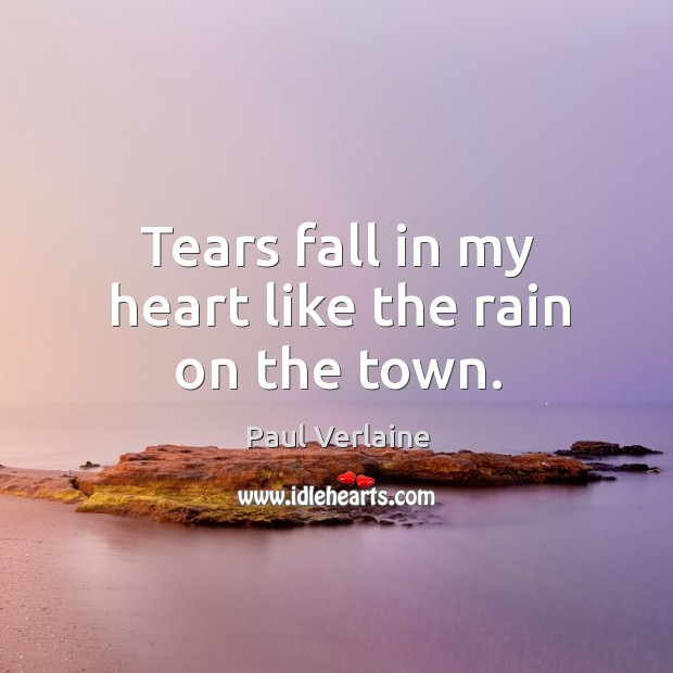 Tears fall in my heart like the rain on the town. Image