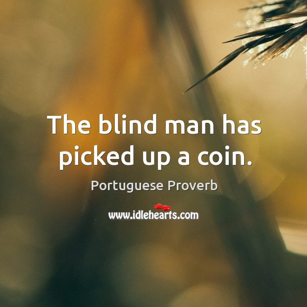 The blind man has picked up a coin. Image