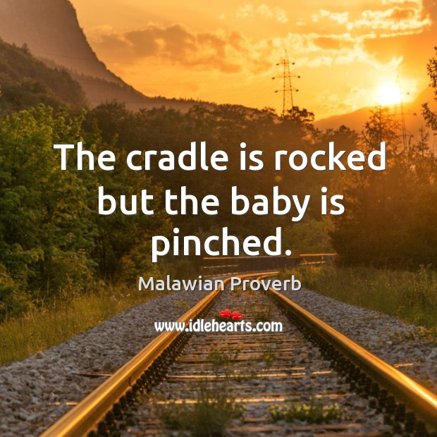 The cradle is rocked but the baby is pinched. Malawian Proverbs Image