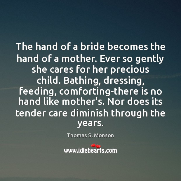 The hand of a bride becomes the hand of a mother. Ever Image