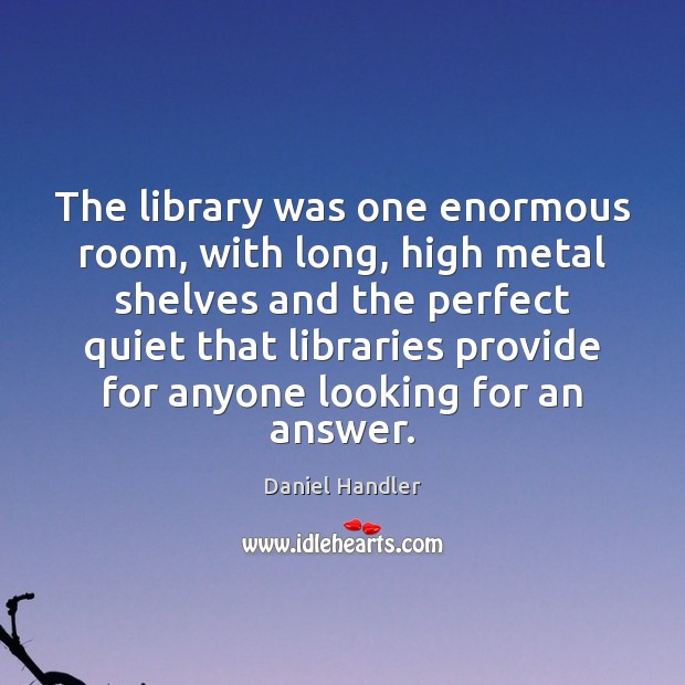 The library was one enormous room, with long, high metal shelves and Image