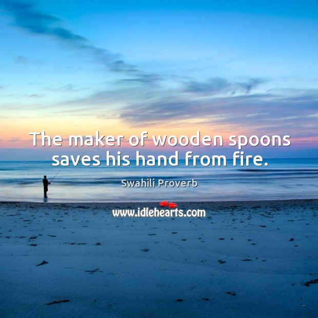 Image, The maker of wooden spoons saves his hand from fire.