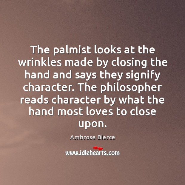The palmist looks at the wrinkles made by closing the hand and Image