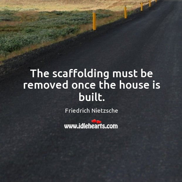 The scaffolding must be removed once the house is built. Image