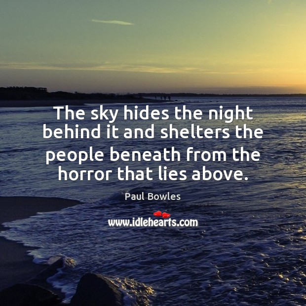 The sky hides the night behind it and shelters the people beneath Image