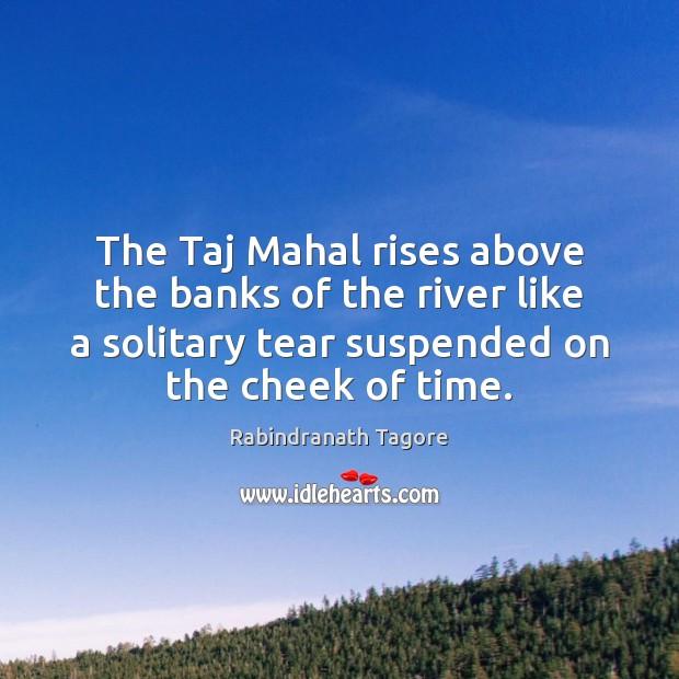 Image, The Taj Mahal rises above the banks of the river like a