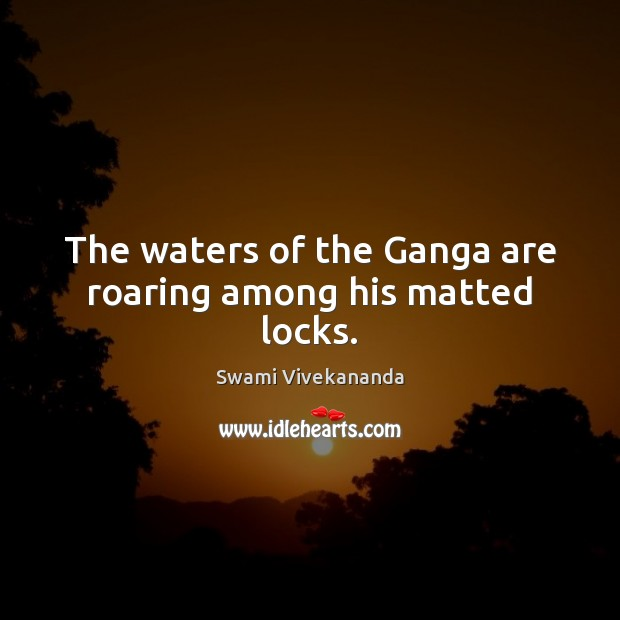 The waters of the Ganga are roaring among his matted locks. Image