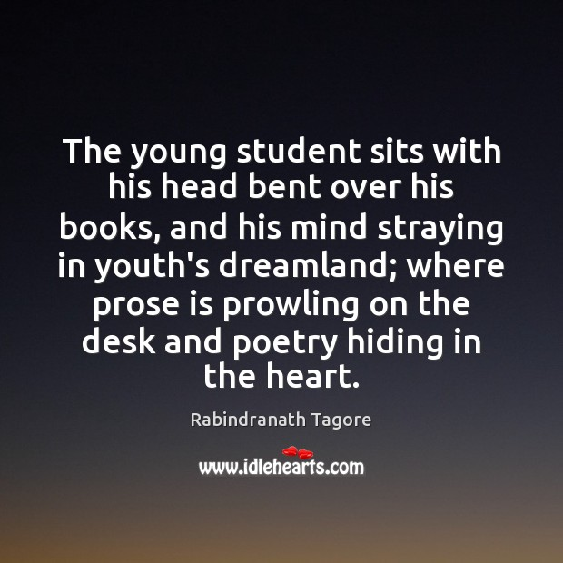 Image, The young student sits with his head bent over his books, and