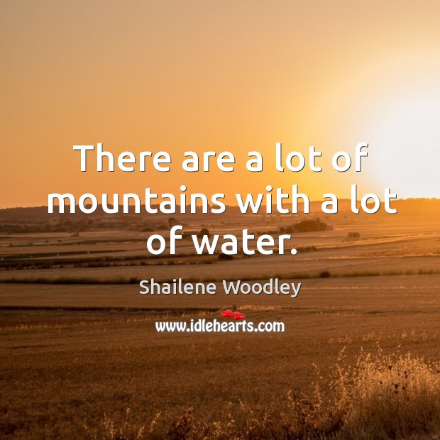 There are a lot of mountains with a lot of water. Image