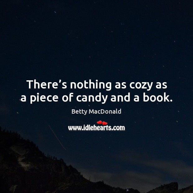 Image, There's nothing as cozy as a piece of candy and a book.