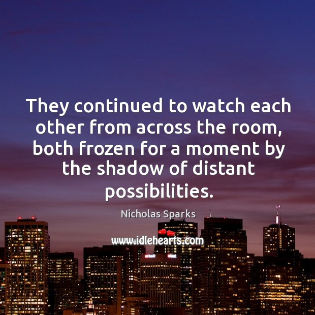 They continued to watch each other from across the room, both frozen Image