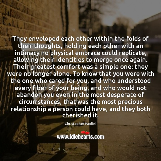 They enveloped each other within the folds of their thoughts, holding each Christopher Paolini Picture Quote