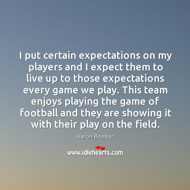 This team enjoys playing the game of football and they are showing it with their play on the field. Image