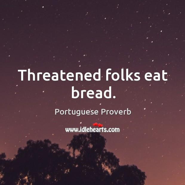 Image, Threatened folks eat bread.