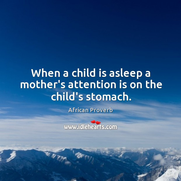 Image, When a child is asleep a mother's attention is on the child's stomach.
