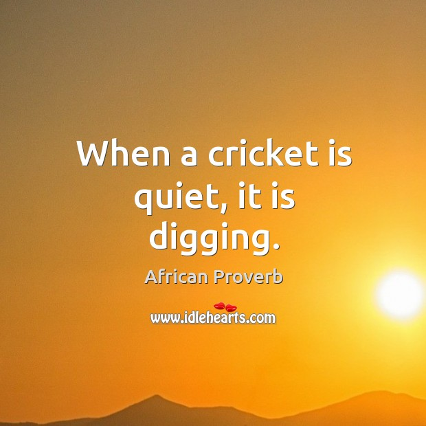 Image, When a cricket is quiet, it is digging.