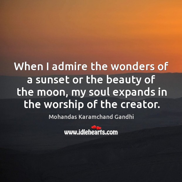 When I admire the wonders of a sunset or the beauty of the moon Mohandas Karamchand Gandhi Picture Quote
