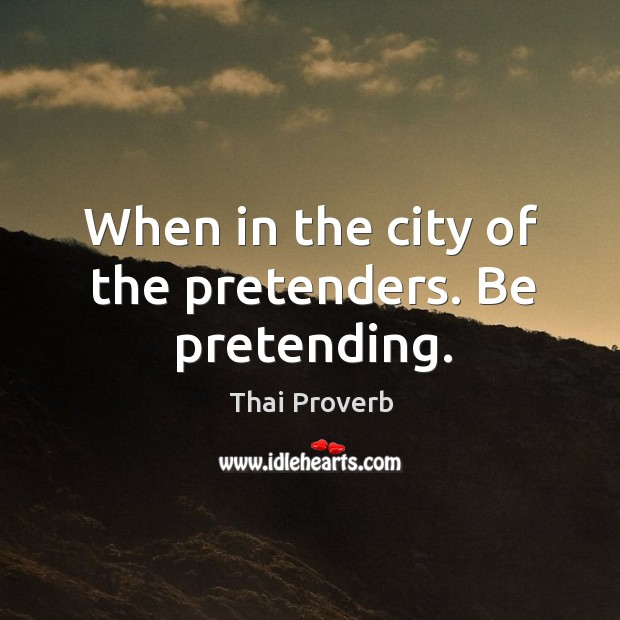 When in the city of the pretenders. Be pretending. Thai Proverbs Image