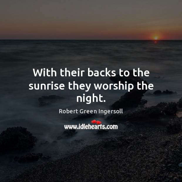 With their backs to the sunrise they worship the night. Image
