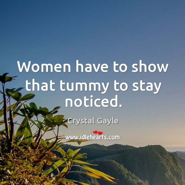 Women have to show that tummy to stay noticed. Image