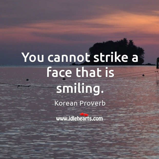 You cannot strike a face that is smiling. Korean Proverbs Image